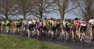 The back of the peloton on A422 after Inberrow for fourth time